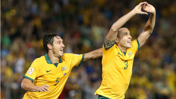 Jason Davidson and Mark Milligan celebrate the Socceroos second goal on Tuesday night.