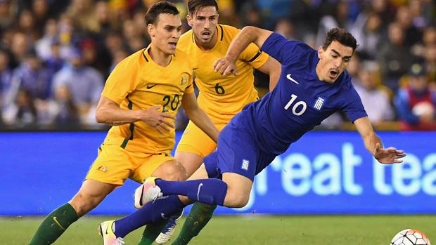 Trent Sainsbury fights for the ball during Australia's 2-1 loss to Greece.