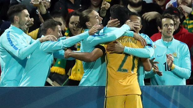 The Caltex Socceroos celebrate Mass Luongo's opener against Iraq.
