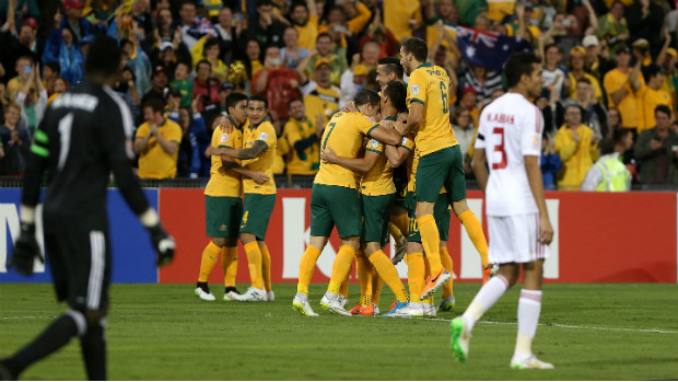 The Socceroos embrace each other after scoring against the UAE.