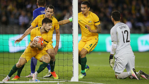 Mat Leckie grabs the ball after Trent Sainsbury's goal against Greece at Etihad Stadium.