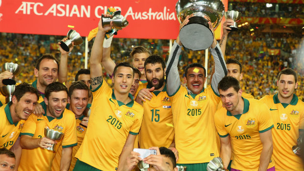 The Socceroos hold the Asian Cup aloft after clinching victory in the final.