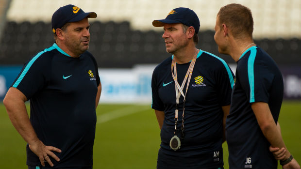 Caltex Socceroos coach Ange Postecoglou talks to assistants Ante Milicic and Josep Gombau.