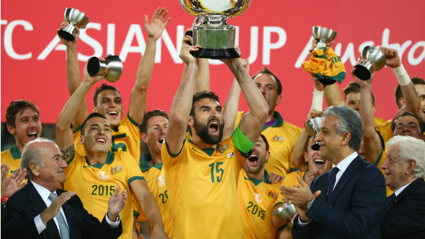Socceroos skipper Mile Jedinak lifts the AFC Asian Cup.