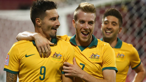 Jamie Maclaren celebrates after scoring Australia's second against Vietnam.