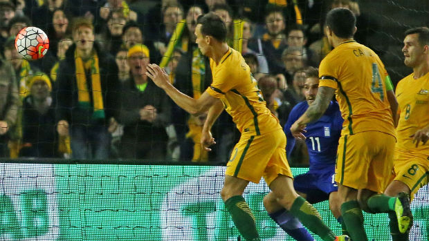 Trent Sainsbury scores against Greece the last time the Caltex Socceroos played in Melbourne.