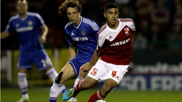 Massimo Luongo scoots away from Chelsea's David Luiz in last season's League Cup.