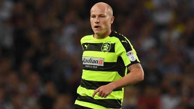 Midfielder Aaron Mooy in action for Huddersfield Town in the Championship.