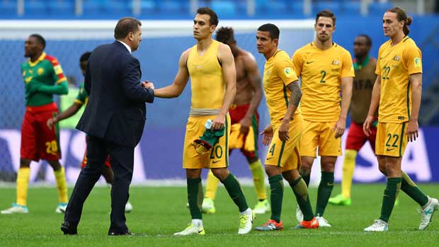 Ange Postecoglou congratulates his players after the 1-1 draw against Cameroon at the FIFA Confederations Cup.