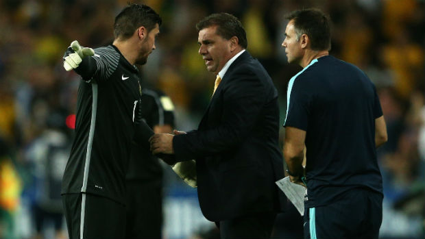 Coach Ange Postecoglou passes on some instructions to goalkeeper Mat Ryan.