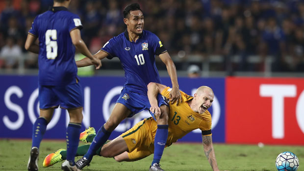 Thailand's Teerasil Dengda challenges for the ball with Socceroos midfielder in November's WCQ.