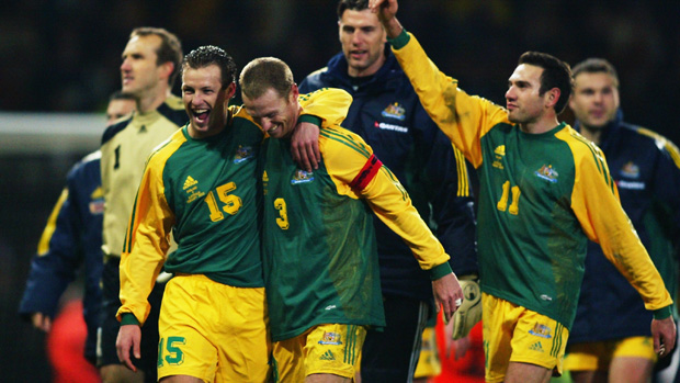 Socceroos players celebrate their 3-1 win over England at Upton Park.