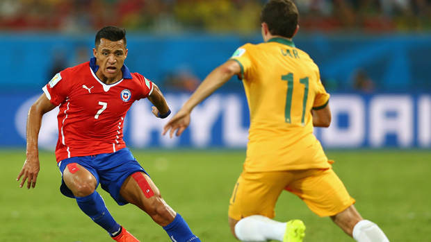 Chilean superstar Alexis Sanchez in action against the Socceroos at the 2014 World Cup.