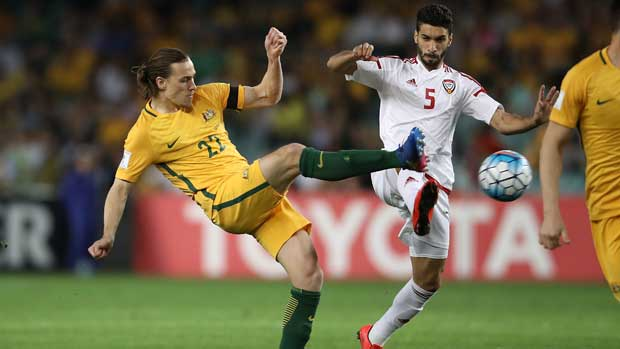 Jackson Irvine challenges for the ball with a UAE defender.