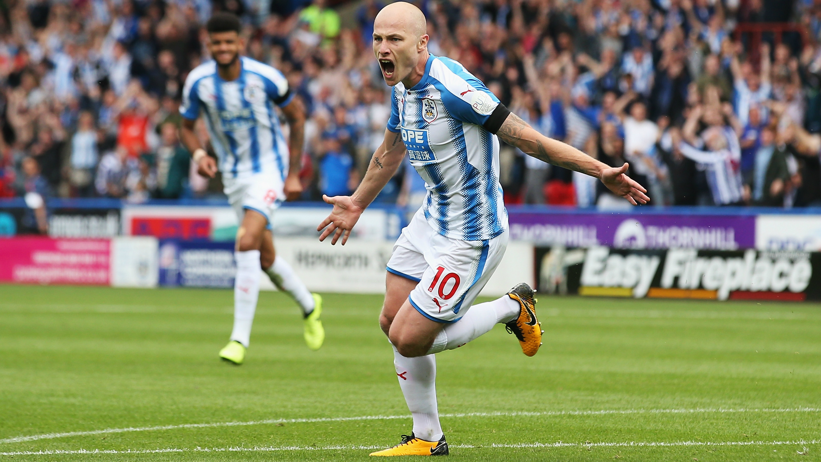 Aaron Mooy celebrates after scoring a superb winner for Huddersfield Town in the EPL against Newcastle United.