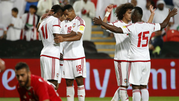 UAE players celebrate scoring against Palestine in World Cup qualifying.