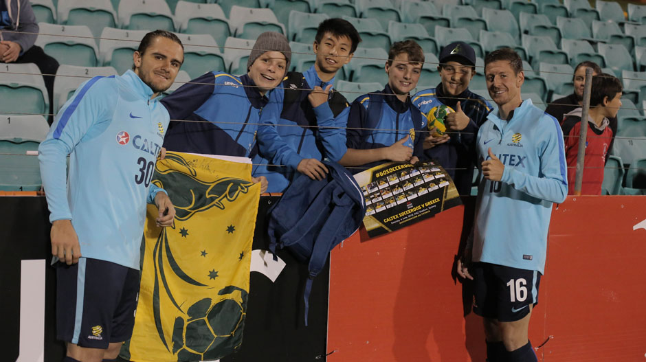 Josh Ridsdon and Nathan Burns with Socceroos fans.