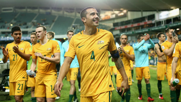 Tim Cahill leads the Caltex Socceroos off Allianz Stadium after they beat Jordan in World Cup qualifying.