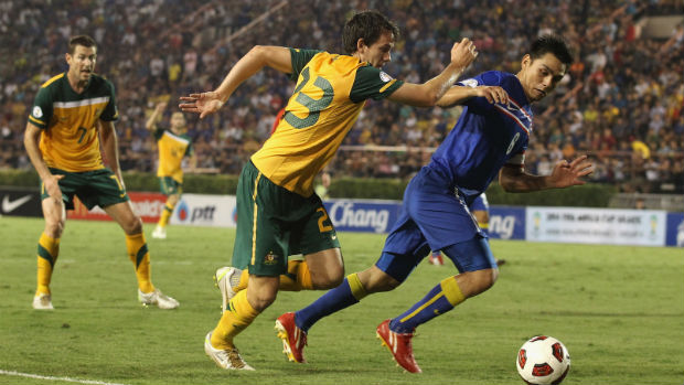 Robbie Kruse jostles for the ball when the Caltex Socceroos last played Thailand in Bangkok in 2011.