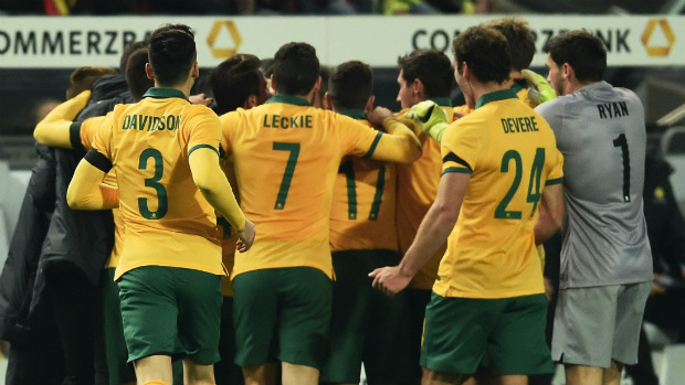 The Socceroos celebrate Mile Jedinak's goal against Germany.