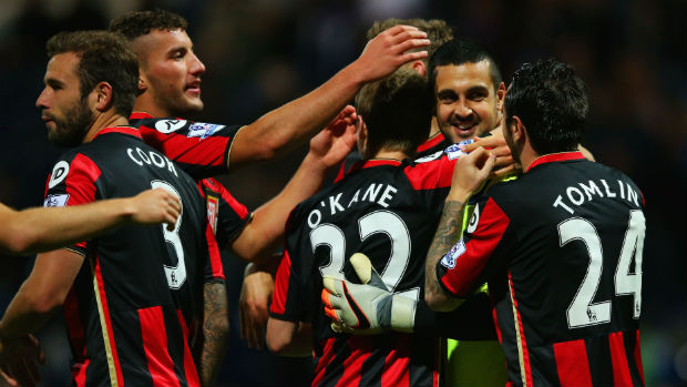 Bournemouth goalkeeper Adam Federici is congratulated by teammates after his shoot-out heroics.
