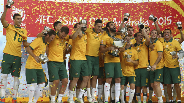 The Socceroos celebrate after winning the Asian Cup final.