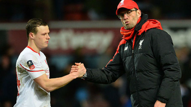 Liverpool defender Brad Smith shakes hands with manager Jurgen Klopp.