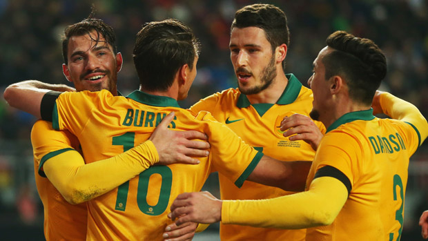 Socceroos players celebrate a goal in their 2-2 draw with Germany in March.