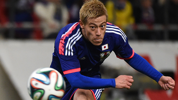 Keisuke Honda connects with the ball during Japan's win over Honduras.