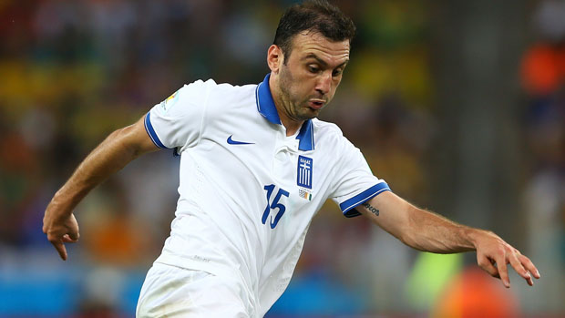 Greece star Vasilis Torosidis in action against Portugal in a friendly in 2014.