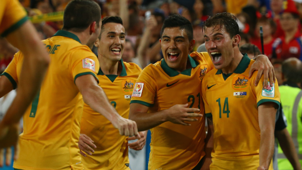 The Socceroos celebrate James Troisi's extra-time winner in the Asian Cup final.
