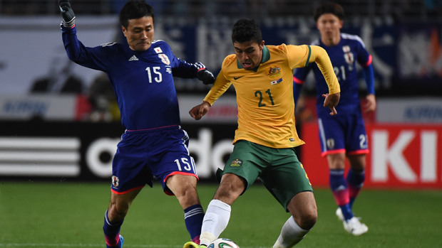 Massimo Luongo on the ball against Japan during a 2014 friendly.