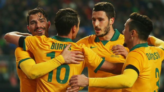 The Socceroos celebrate James Troisi's goal against Germany.