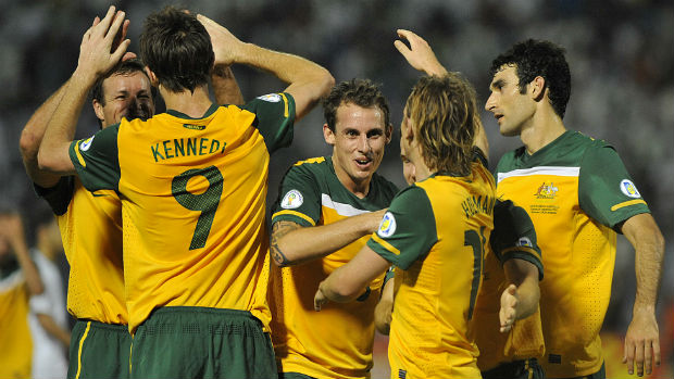 The Socceroos celebrate Josh Kennedy scoring against Saudi Arabia in 2011.