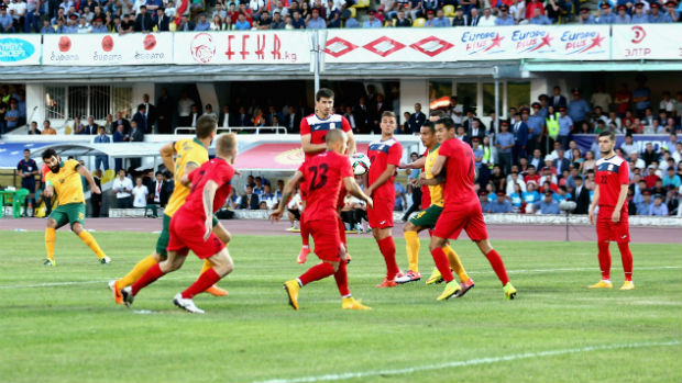 Mile Jedinak scores in the opening minute from a free-kick against Kyrgyzstan.