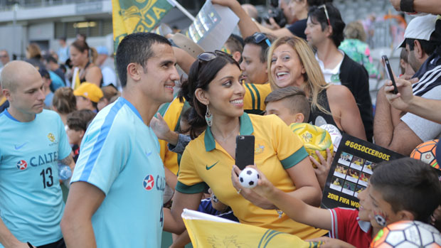 Tim Cahill with fans in Sydney.
