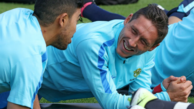 Mark Milligan on the training ground alongside Massimo Luongo.
