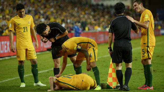 Robbie Kruse is injured by a horrific second-half challenge against Jordan.