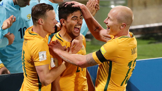 Massimo Luongo celebrates with Aaron Mooy and Brad Smith after opening the scoring against Iraq in WCQ.