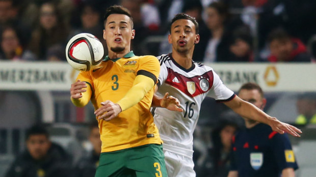 Socceroo Jason Davidson goes up for the ball against Germany's Karim Bellarabi.