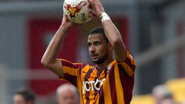 Bradford City defender James Meredith takes a throw-in in the FA Cup.