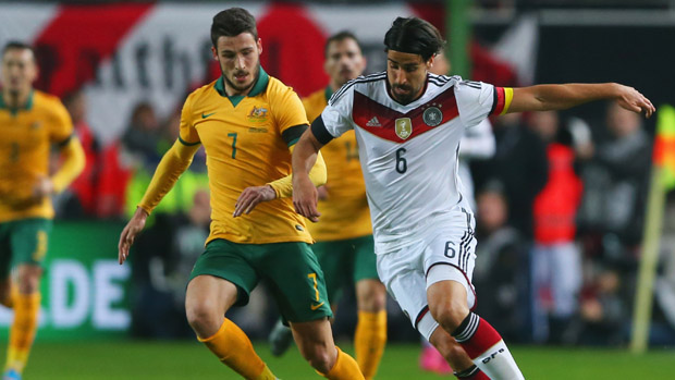 Socceroo winger Mat Leckie fights for the ball with German midfielder Sami Khedira.