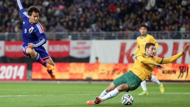 Japan's Shinji Okazaki unleashes a shot on goal during a friendly against the Socceroos in 2014.