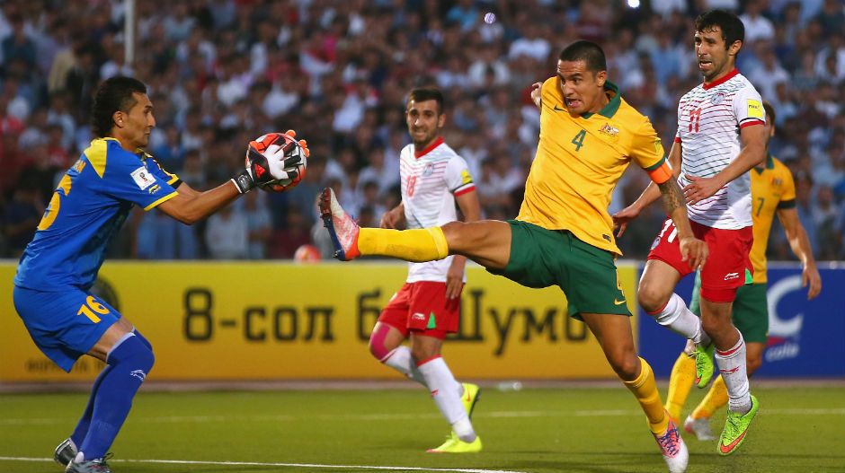 Tim Cahill is just beaten to the ball by Tajikistan's goalkeeper.
