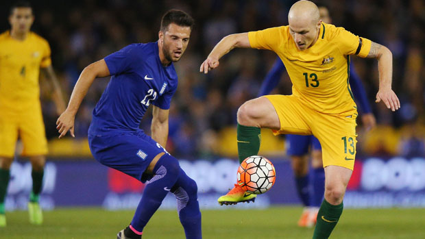 Aaron Mooy controls the ball during Australia's 2-1 loss to Greece in Melbourne.