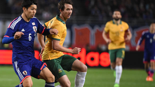 Socceroo Robbie Kruse fights for the ball with Japan's Masato Morishige in a 2014 friendly.