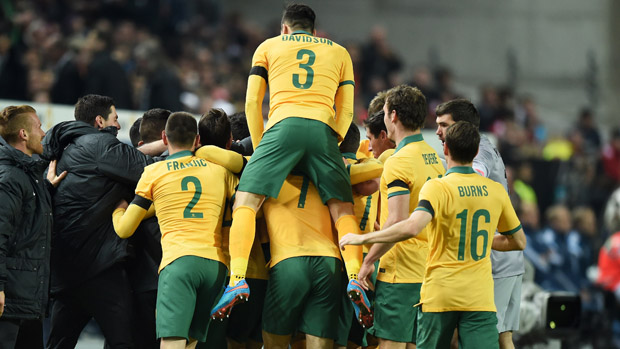 Socceroos players celebrate Mile Jedinak's goal against Germany.