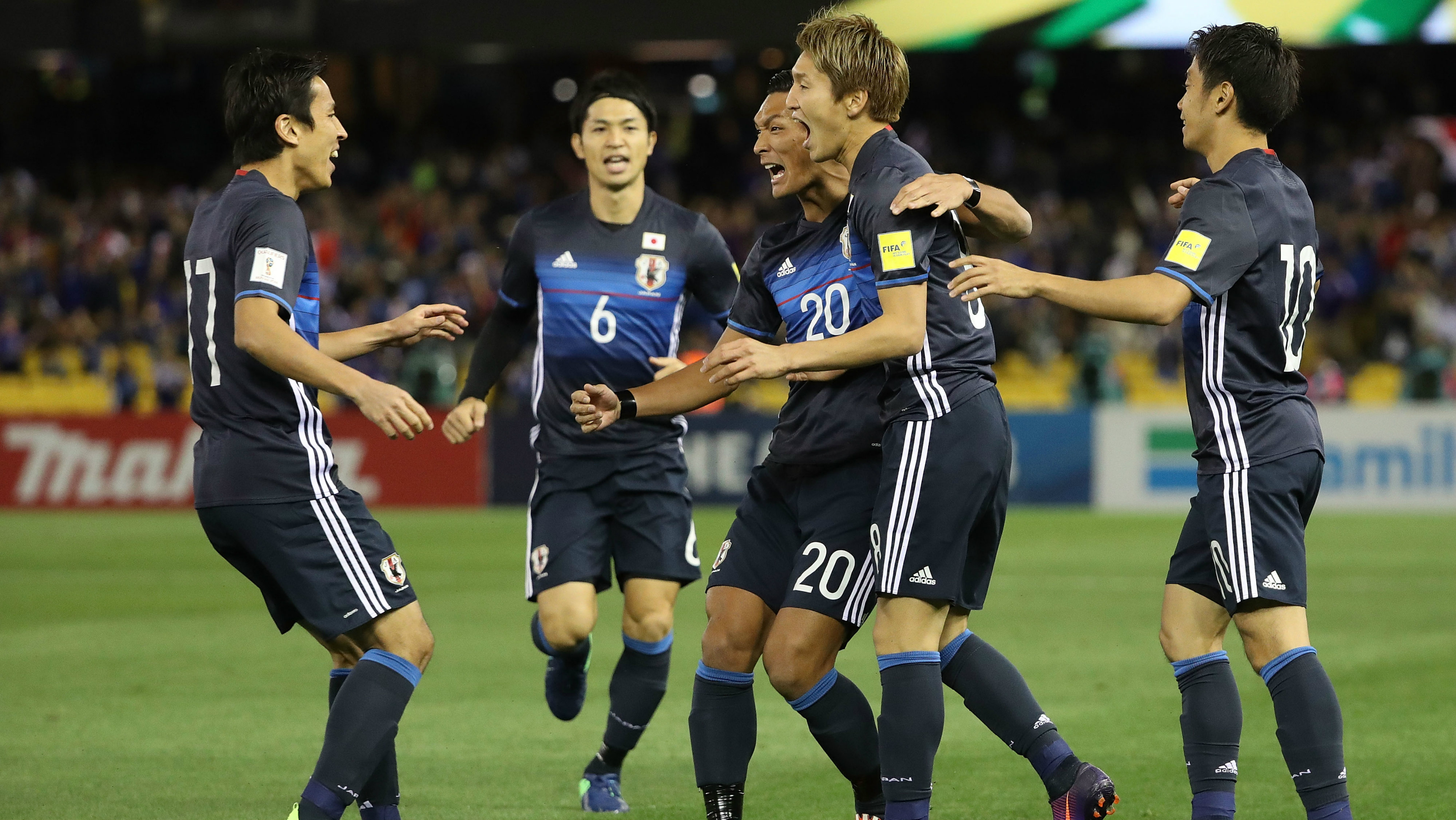 Japanese players celebrate a goal in their 1-1 draw with the Caltex Socceroos in October, 2016.