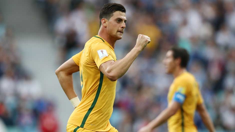 Juric celebrates giving Australia a lifeline back into the match.