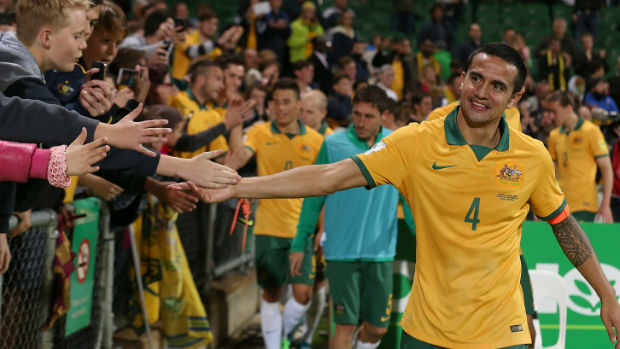 Tim Cahill thanks the fans after the Socceroos beat Bangladesh in Perth in September.